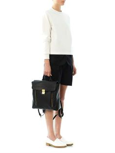 White loafers with tailored black shorts and white sweatshirt.   Alexander Wang Hilary peroxide slip-on shoes