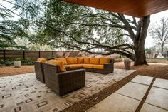 Rich wood ceilings, floors and accent walls throughout give this modern University Park, Texas, home a warm ambiance. The open floor plan is complemented by folding-glass doors that can be opened for true indoor-outdoor living.