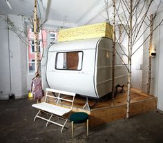 Hüttenpalast is a new unconventional hotel, located in a former factory building in the residential district Neukölln in southern Berlin.    Hotel rooms are made up of caravans and wooden huts that are placed in a 200 sq meter warehouse space.