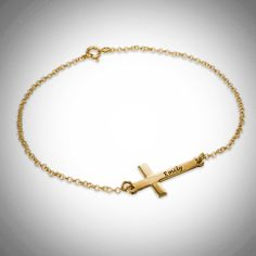 Engraved Side Cross Bracelet This beautiful Bracelet is 18 K Gold Plated .925 Silver and comes Engraved with your choice of name will only include one capital letter and only one name per bracelet. Simply Beautiful ! Please specify name and length you prefer. Please allow 14 days for delivery ...