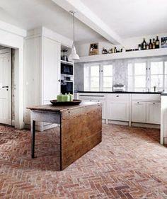 Interior brick flooring with wax in the kitchen