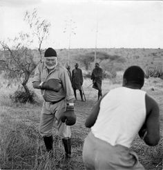 """Ernest Hemingway boxing in Africa. [after reading """"green hills of africa"""" and seeing this. my life is complete now! Ernest Hemingway, Rare Historical Photos, Art Of Manliness, Andre Kertesz, Story Writer, Albert Camus, Book Authors, Old Photos, Rare Photos"""