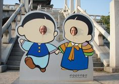 These photo coutouts were put out in front of the National Folk Museum of Korea on Chusok, the Harvest Moon Festival, Korea's biggest holiday. These cartoon type figures are popular in Korea, even as official mascots for the 1988 Summer Olympics.