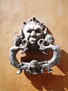 This is one of the things I love about the Italians, they take a simple functional object like a door handle/knocker and turn into a work of fine art!