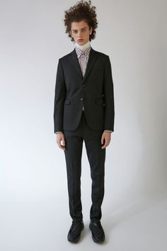 Acne Studios Brobyn Trouser Pique black are slim fit, tailored leg trousers. This style are constructed on a modern stretch wool pique and feature two hidden coin pockets. This style is received unhemmed, allowing the customer to choose preferred trouser length.