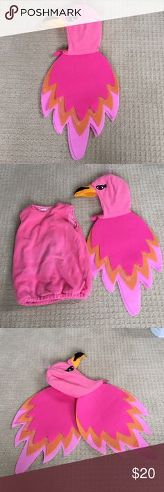 Pottery Barn Kids flamingo costume Super cute flamingo costume worn once. Two piece costume with fleece body suit. Pair it with black or pink leggings and a long or short sleeve shirt underneath depending on what the weather is like for your Halloween! Slight fading in front of fleece from dryer. Otherwise in great condition. Pottery Barn Kids Costumes