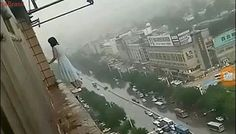 Suicidal woman 18 storeys building in China