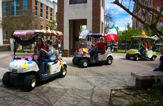 """Students decorate golf carts for the Parade of Values in hopes of winning """"Best In Show"""" as part of the festivities celebrating Incarnate Word Day."""