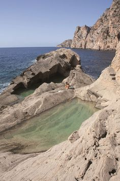 A natural swimming pool in the rock at the almost-mythical Sa Pedrera beach, known as 'Atlantis' to islanders, in Ibiza.