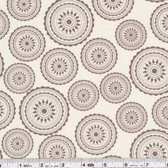 We have a huge fabric crush on Sweetwater's new collection, Mama Said Sew... the color palette is striking, the prints versatile together or as stand-alones, and there's a lot of grey! Elegant medallions are printed in multiple sizes on this print. This quilting weight fabric is 44/45