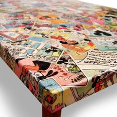 Table boring you?! Decoupage It! W/Mod Podge Furniture Grade Glue..& Comics!!!! 3 coats at least, satin finish.... Source not known , but DIY :) Easy.........