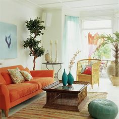Vibrant open-plan living room    Ellipse sofa  The Conran Shop  Birdcage rattan table  Oka  Wrought-iron tables and Paris chairs  The Greenhouse Effect  Painted Fineweave armchair   Marston & Langinger  Faux fig tree  Sia at Figaro Interiors  Moroccan leather pouffe, Chinese lantern  Graham & Greene      Read more at http://www.housetohome.co.uk/living-room/picture/vibrant-open-plan-living-room#wXw8cZfbsKzyX9jC.99