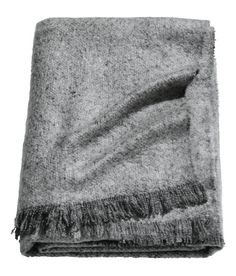 Check this out! Throw in soft, woven melange fabric with fringe on short sides. - Visit hm.com to see more.