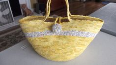 Imagine making this bag from some clothesline, fabric and zig zag stitching.  It can be done.  Y'all take a class.