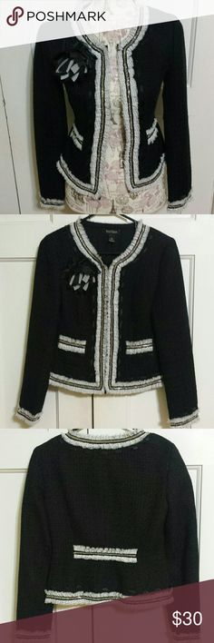 """White House Black Market Boucl'e Jacket Black with White ruffledtrim wth black polka-dots Silvertone chain accents  2 pockets  Removable flower pin. Lined 53 poly 47 cotton shell. Polyester lining  & shell. Hook and eye closures. 19"""" long  Dry clean only. Like New Condition White House Black Market  Jackets & Coats"""
