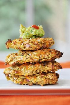 Oil free zucchini and carrot fritters that are crispy, crunchy, and delicious! Easy to make and even easier to eat. Perfect for dinner or an appetizer.