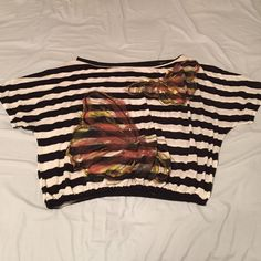 Rue 21 Striped Butterfly Top Soft t-shirt material with an elastic waist band at the bottom and metallic butterflies. Gently used. Elastic still works perfectly but there is slight balling on some places on the fabric. Rue 21 Tops