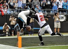 Carolina Panthers quarterback Cam Newton (1) dives into the end zone for a touchdown as Atlanta Falcons' Chris Owens (21) pursues during the second half of an NFL football game in Charlotte, N.C., Sunday, Dec. 9, 2012. (AP Photo/Rainier Ehrhardt)    Read more here: http://www.charlotteobserver.com/2012/12/09/3716507/panthers-make-most-of-2nd-shot.html#storylink=cpy