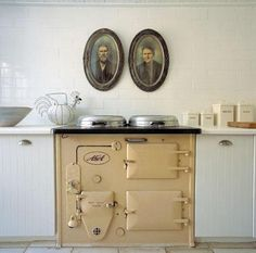 Hunters & Gatherers at Home: Cream & White - love the portraits above the Aga