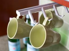 Are you running low on cabinet space? A slide-out coffee cup rack offers plenty of space for hanging your everyday mugs.