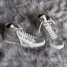 Common Projects Tournament Trainers Silver leather high-top sneakers. Worn only twice for short periods of time. Size 38, but runs about a half size big. Would fit an American size 8-8.5. Common Projects Shoes Sneakers