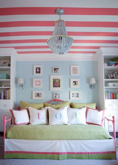 Lily Pulitzer pink aqua light green big girl room for Lou features peach stripes on ceiling and personalized pillows on the bed