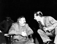 Charles Laughton and Mickey Rooney find something to laugh about
