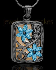 Black rhodium plated and blue spring flower garden cremation jewelry gives family unique memorial to a loved one.