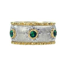 """Buccellati """"Capri"""" band ring designed as a textured white gold band with a scalloped yellow gold trim and set with 6 circular-cut emeralds mounted in yellow gold with chased borders. Emerald Band Ring, Aquamarine Rings, Queens Jewels, Jewelry Accessories, Jewelry Design, Family Jewels, Ring Designs, Band Rings, 18k Gold"""
