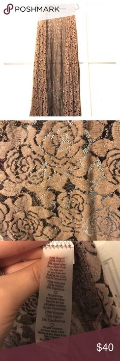 Lularoe large tan lace rose joy vest This beautiful joy vest features a black mesh  background with laced tan roses stitched into the mesh fabric. This joy has plenty of stretch so it can easily fit someone who is an XL, I would recommend sizes 12-18. Only worn once! LuLaRoe Other