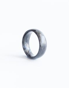 Carbon Fiber like you've never seen it. Thanks to our unique forging method, all of our rings have a unique marbled design that catches light to reveal deep, radiant layers.
