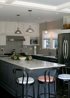 dark gray, light gray, white and black upper cabinets different from lower cabinets