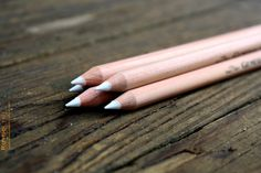 This listing is for (1) white chalk pencil for use on our wedding chalkboards, kitchen chalkboards etc.  We use Generals® Charcoal White®