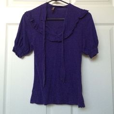 Purple ruffles neck tie shirt *free* Xs v neck purple shirt with ruffled collar and ties that can be tied at the neck. Retro style Very mad men esque. ☺️  ✨list price or free with 25$ purchase or more! Please be sure to mention this item with your purchase if you would like it as a free gift!✨ Old Navy Tops