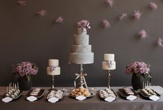 This yummy-looking table with custom purple garland, tiered grey cakes, coordinating cupcakes, and ivory and lavender cake pops fits the colour theme and every guest's sweet tooth. Dessert Buffet, Dessert Bars, New York Kuchen, Wedding Desserts, Wedding Cakes, Cake Pops, New York Cake, Our Wedding, Dream Wedding