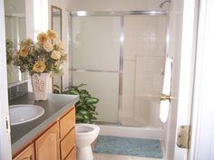 Traditional 3/4 Bathroom with Wilsonart laminate in salentina argento, Stone…
