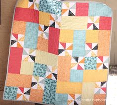 Baby Boy Pinwheels Quilt in Red, Orange, Blue, Yellow, and Green. $90.00, via Etsy.