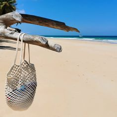 Make a statement at the beach or even at your local market with our unique net bag! Made from 100% cotton rope, our net bags are durable and expand as more goods are placed in the bag.   Mia Mélange bags are made from 100% cotton rope which we carefully sew together in a coiling technique. The cotton is grown locally in South Africa by farmers who are members of the Better Cotton Initiate (BCI). Net Bag, Cotton Rope, Ivory, South Africa, Bags, Farmers, Unique, Sew, Products