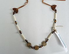 Beautiful leopardskin jasper beads have melded with genuine bone and wooden beads in this necklace, hand made necklace, soho, boho