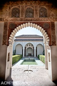 The Detailed archway of the Cuartos de Granada at the Alcazaba of Malaga, Spain | CheeseWeb