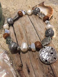 Beachy sand dollar bracelet  Silver beads and by SunnybeachDesign
