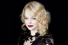 Emma Stone is almost unrecognizable in this retro-glam look. The lips are the perfect finishing touch.