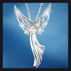 Guardian Angel Of Love Swarovski Crystal Pendant Necklace: Graceful and serene, this glorious guardian angel pendant necklace is ready to watch over you or someone you love. Her splendid wings surround you with a peaceful presence, and in her hands she holds a shimmering heart - a keepsake of love that will nestle perfectly close to your heart!