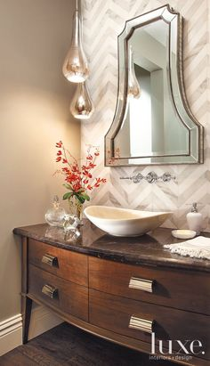 In the powder room, a sink by Avanity pairs with a Grohe faucet.