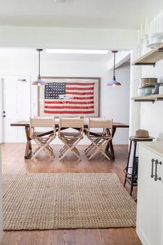 A custom-framed, 48-star American flag takes center stage in the dining area of this ranch-style California home.