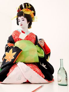 A woman dressed as an oiran at a photograph experience.