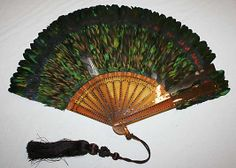 Fan  Date: late 1880s Culture: American or European Medium: feathers, plastic, metal Dimensions: Height: 10 1/2 in. (26.7 cm) http://www.metmuseum.org/Collections/search-the-collections/80034839?rpp=20=8=*=Fans=143