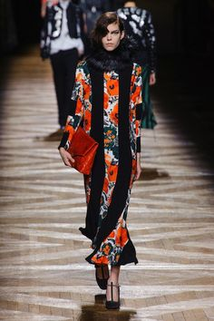 Pieces That Will Fly Off Retail Shelves From Paris Fashion Week: Everything about this look is so  sultry and feminine. The mix of  floral and velvet makes this look perfect for day or evening. Dries always gives us prints that are   timeless. The new update on floral for fall will have a warm welcome from Dries fans everywhere.