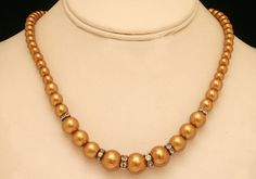 An elegant gold color beaded necklace-04BEAD29  http://www.craftandjewel.com/servlet/the-1499/An-elegant-gold-color/Detail