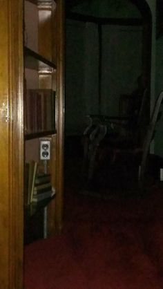 This photo was taken by AJ Paranormal during their investigation at the Cottage. It is looking from the religious parlor through the short hallway into the southeast parlor. See the short shadow figure?!  Check out AJ Paranormal's page https://www.facebook.com/pages/AJ-Paranormal-Research/392720014169269?fref=ts